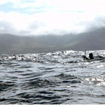Disappearing amongst the waves. Blacks seas and a black kayak…