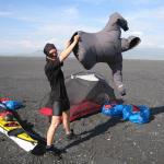 "Flying a ""Kokatat"" kite in the warm black desert wind"
