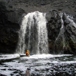 Paddling under waterfalls...