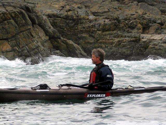 Greg Stamer in Nigel Dennis Sea Kayak near cliffs in Newfoundland 2008