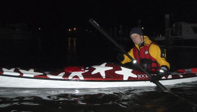 Night paddle -- a student tries out my carbon Greenland paddle