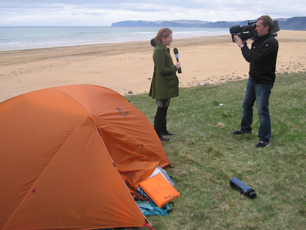 News crew reporting at our campsite