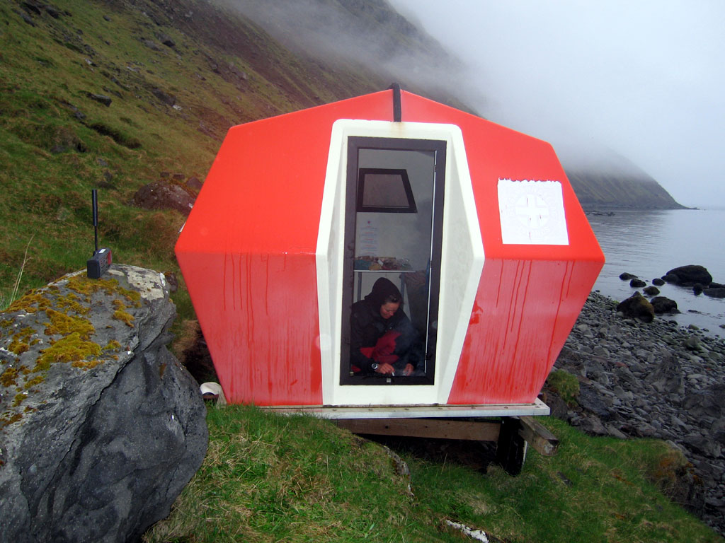 A modern mariner's shelter. Orange refuge shelters ring the coast.