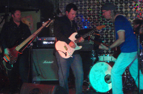 Russell (right on guitar) playing with his band Sisemore, Saturday night